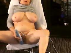 Mature woman masturbates to intense orgasm