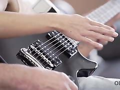 old4k. young lassie makes some noise with old bass-guitar