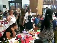 A woman with huge between doctor and patient dancing at the wedding