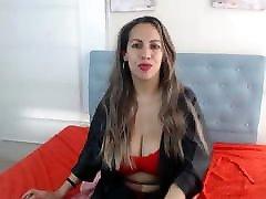 Mature Latina teases with huge tits and licks nipple