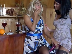 Blonde girl fucked in the ass with a strapon by lesbian with long nails