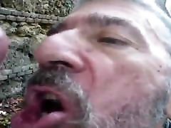 Old fag sucking off big cock in the forest