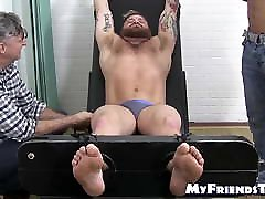 Muscular jocks tied and repeatedly tickled on smelly feet