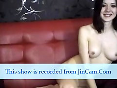 Gothic camgirl masturbates with finger on webcam
