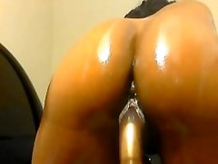Sexy ebony babe dildoing her pussy on webcam