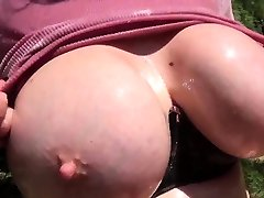 Lady Sonia lubes up her tits and masturbates outdoors