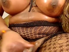 Busty ebony shemale sweats from jerking off and cums