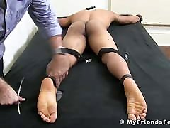 Tattooed muscle hunk tied up for barefoot tickling torment
