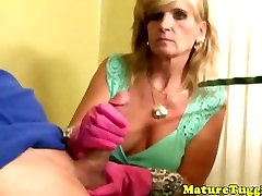 Mature nirmala indiyn tugs with rubber gloves on