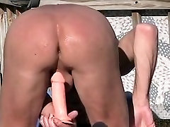 Me naked outside playing with 2 different suction cup dildos.