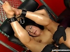 Oriental girl is tied down and given orgasms with sex toys