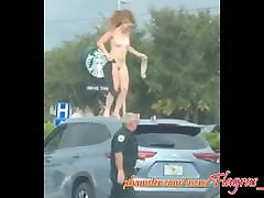 Naked woman shows off on top of car on avenue