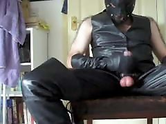 Leather Master in hood and thigh boots