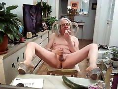 Naked slut fucking a big cucumber