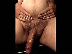 rubbing full ball belly makes hung veiny cock hard