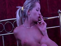 skinny girl smoking a cigar