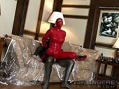 Couple in latex suits