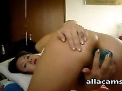 Asian amateur fucks her own ass on webcam