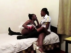 Hot Ebony lesbians toy their assholes with a dildo