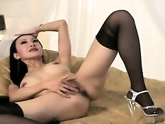 Big tit Asian chick getting her picture taken