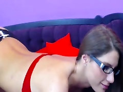 Attractive girl with glasses sensually touches herself on t