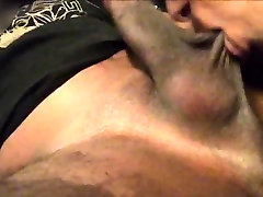 Chocolate gal blowing a meaty bdsm lesbian strapon dick