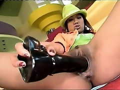 Asian babe rides a massive schlong