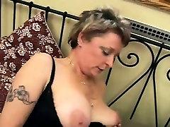 Granny with dildo fucks pussy