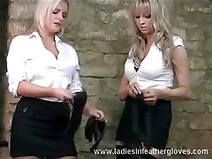 Busty blondes put on leather gloves and caress big tits