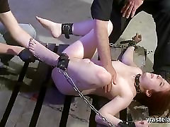 Naked slave chained and made to orgasm by two Masters