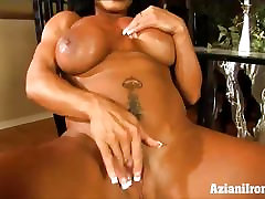Bodybuilder flexes her muscles and fingers herself