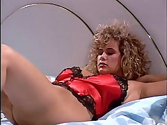 Blonde fucked in pussy and ass on bed