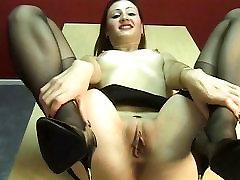 Sexy brunette secretary spreads her juicy pink pussy