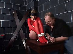 Big tits hottie in red fishnets bound for a gay glory hole box session