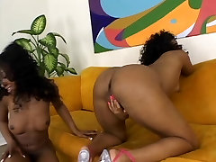 Ebonies with nice tits fuck with vibrators on couch