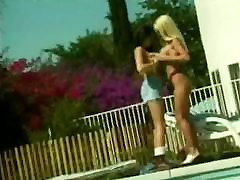 Sexy blonde and brunette lick and tickle each other&039;s cunts at poolside