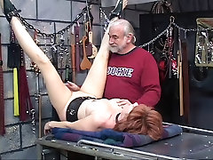 Red haired slut has her legs bound and pulled up while old guy looks on