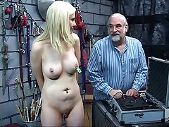 xx teunas pale blonde with clamp on her clit stands so dude can clamp her nipples
