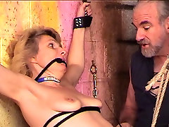 Bondaged and roped titanic full blonde gets her nips and cunt clamped