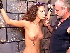 Guy uses fishhooks on naked sexy brunette
