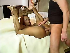 Ebony and sexy bitch is licking huge cock on the bed then fucked