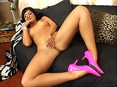Brunette strips panties and masturbates
