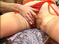 Mature babe in red lingerie takes cock in bed