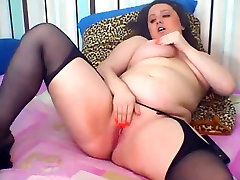 Chubby young brunette with high heels and stocking
