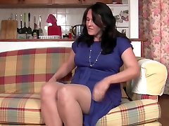 Curvy mom in pantyhose fucks a dildo