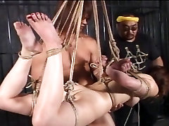 Amateur mixed indian chinese chick bound and suspended from ceiling
