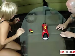 Two guys take on two girls in a morning sex in room of strip table hockey