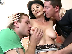 HOT mom bhedroom fucking two young guys at once