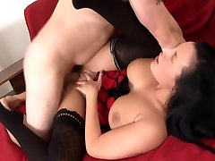 Busty brunette in a nighty and thigh high nylon