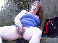Mature BBW masturbating at the pond
